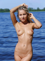 Candice B dips her sexy, hot body in the river.