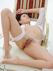Sexy white blouse slightly revealing her   gorgeous puffy breasts brings out   Suzanna's erotic and womanly appeal in a   great series with photographer   Goncharov.
