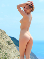 Nikia A suns her naked body on the water