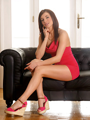 Victoria Daniels confidently poses in a sexy, body-hugging red dress and strappy wedge heels that perfectly showcases her body's gorgeous curves.